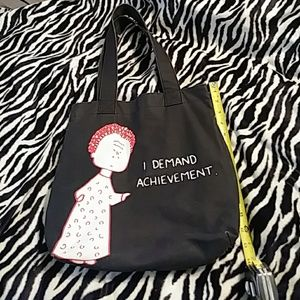 Angry Little Girls tote with exterior side pocket